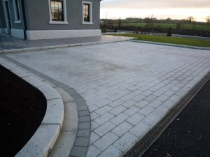 Parking bays with radi kerb and 300x150 granite brick