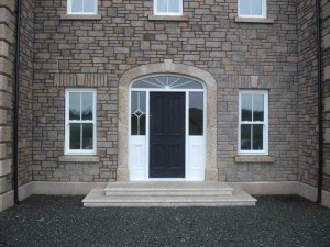 Golden granite door surround and steps with bullnose edge