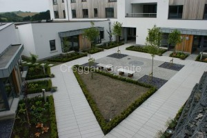 Grey silver granite paving.
