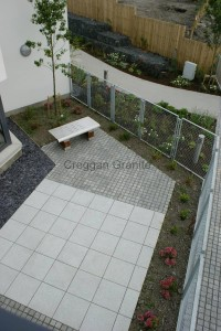 Grey silver granite paving and cobbles.