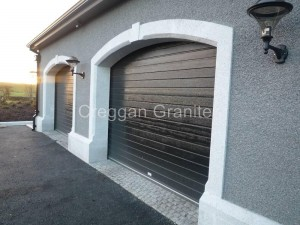 Silver grey, arched, granite garage surround