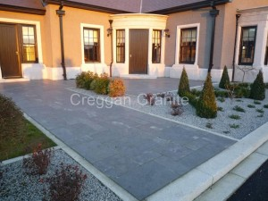 Blue Limestone paving with granite edgings
