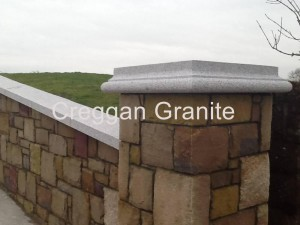 Silver grey granite pier cap and wall coping.