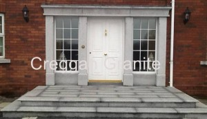 Silver-grey granite door surround