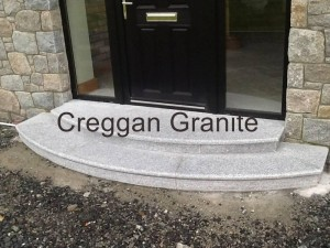 Round, silver grey granite step