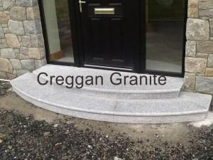 Round, silver grey granite step