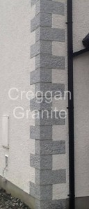 Silver-grey punched granite quoins