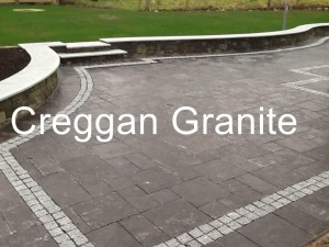 Blue limestone paving with cobble surroundings