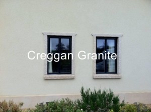 Golden granite clad-on window surrounds