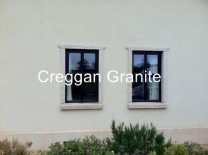 Golden granite clad-on window surrounds