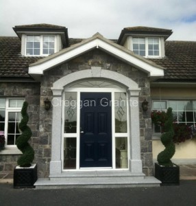 Silver-grey granite door surround with keystone