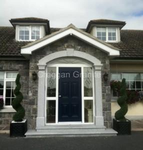 Silver-grey granite door surround with keystone