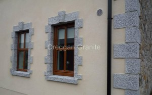Silver-grey granite window surround with Silver grey keystone