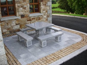 Silver grey Granite slabs and golden granite cobbles