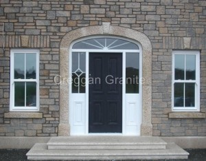 Golden granite steps, door surroundings and key stone.