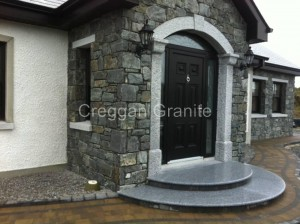 Round, silver-grey, granite step