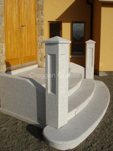 Round, silver-grey granite steps with granite walls and piers